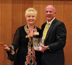 Terri Kane receives the Distinguished Healthcare Executive Award from Intermountain SVP/COO Rob Allen.