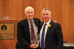 Mark Stoddard (lefts) accepts his Distinguished Service to Healthcare award from UHA President/CEO Greg Bell.