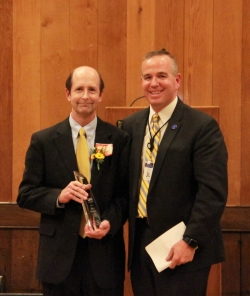 Matt Packard, left, poses with Intermountain South Region VP Steve Smoot and the 2017 Trustee Service Award.